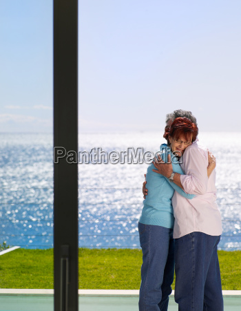 mature man and woman embracing outside