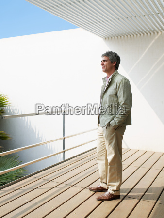 man standing on balcony