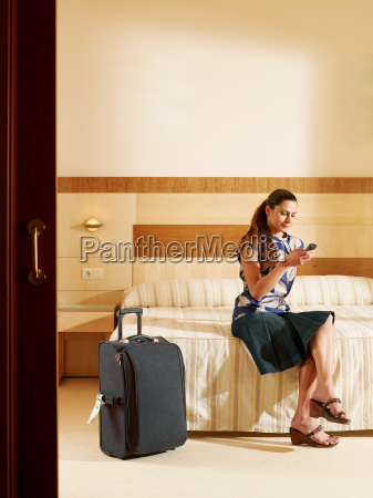 woman sitting in hotel room on