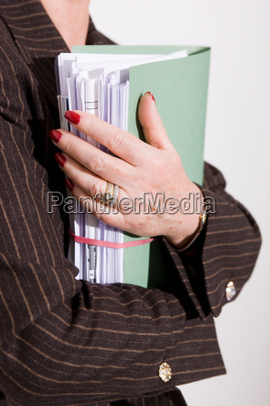 hands holding business papers