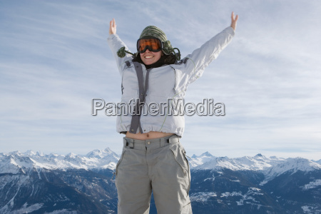 female jumping in snow