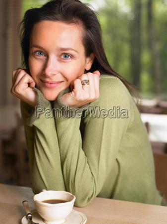 woman holding a mug at a