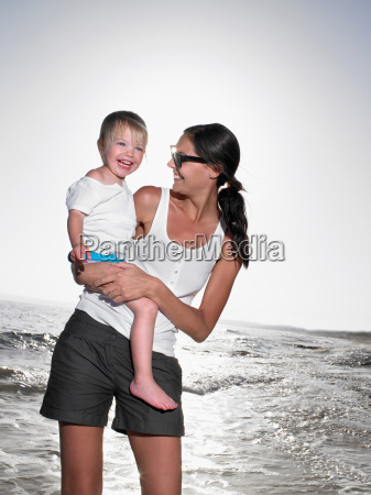 woman holding a young girl at