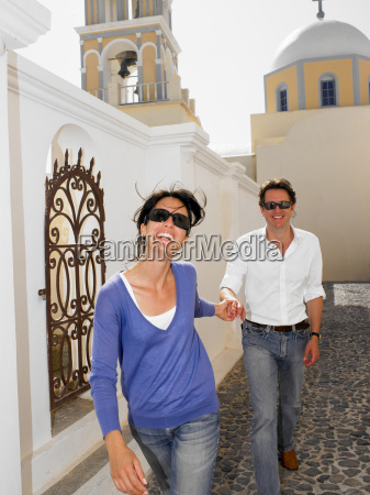 couple smiling with sunglasses on