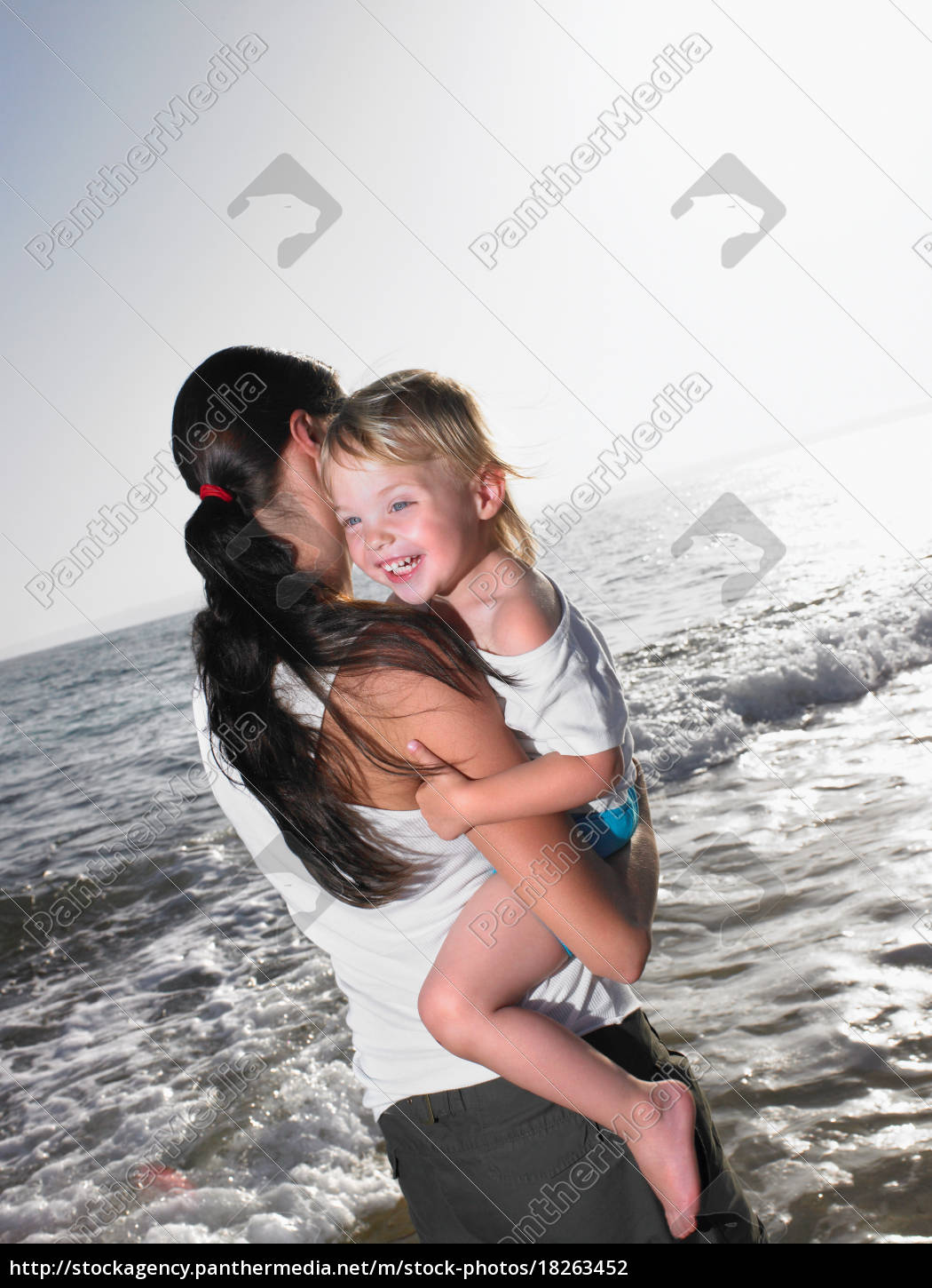 woman, holding, a, smiling, young, girl - 18263452