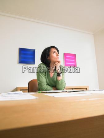 pensive businesswoman at her desk