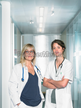 two female doctors looking at camera