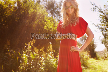young woman in nature wearing red