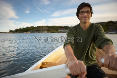 young man in rowing boat