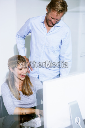 man and women in office at