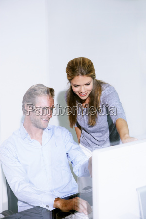 man and woman in office at