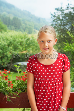 young girl standing outdoors