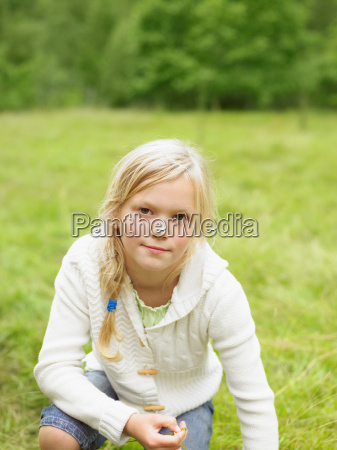 young girl in a field outdoors