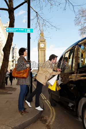 couple with london taxi big ben