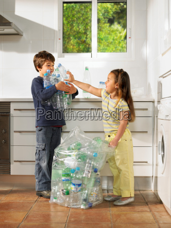 young boy and girl sharing recycling