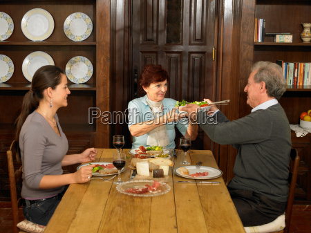 young woman and parents having lunch