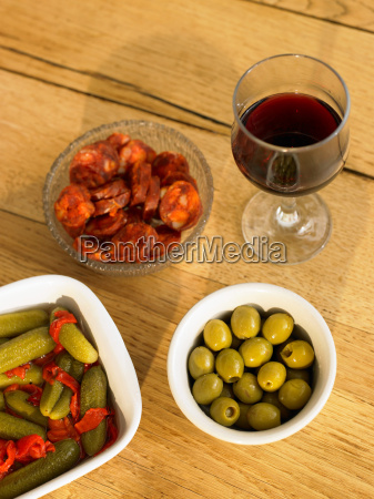 glass of red wine and olives