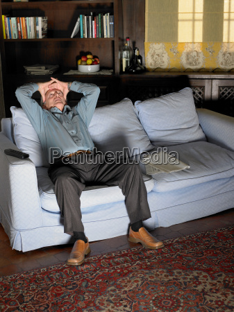 senior adult man sitting on sofa