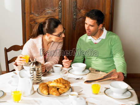 couple sitting at breakfast table