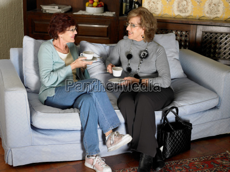 two senior adult women sitting on