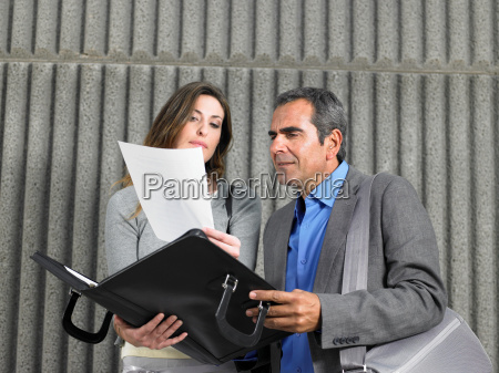 older man and young woman reading