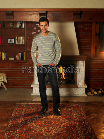 young man standing in living room