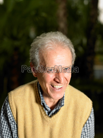 senior adult man in garden smiling