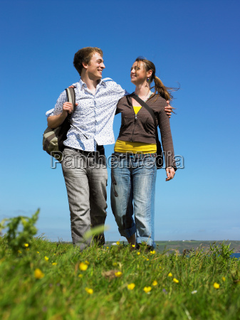 young couple outdoors holding hands