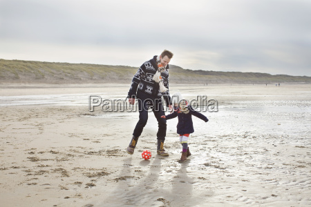 mid adult man with daughter playing