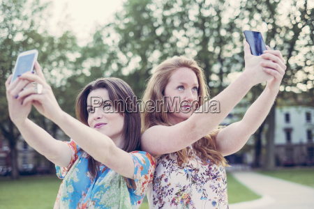 two young female friends taking selfie