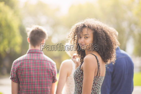 young woman in park with friends