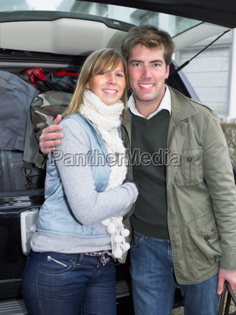 couple in front of packed car