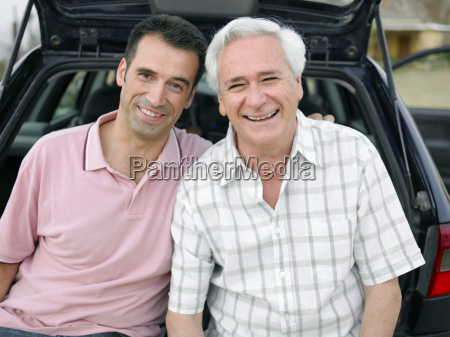 senior adult man and adult son