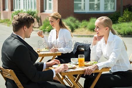 businesspeople eating food in restaurant