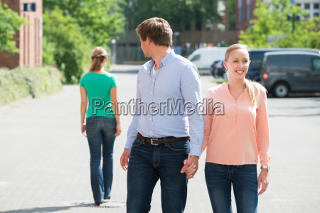 man walking with his girlfriend looking