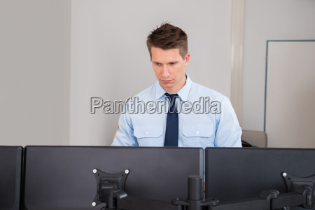security guard standing in control room