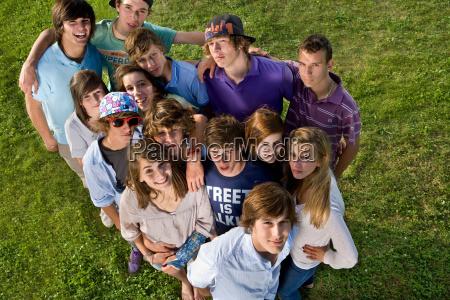 teen group portrait standing looking up