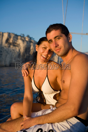 portrait young couple on sailboat