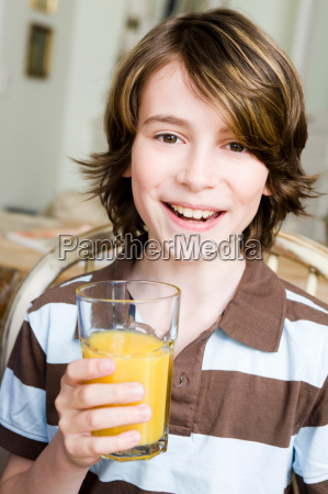 boy smiling with a glass of
