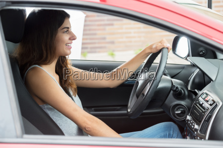 happy woman sitting inside car