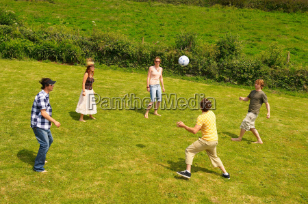 group of five people playing football