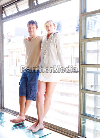 couple standing at window