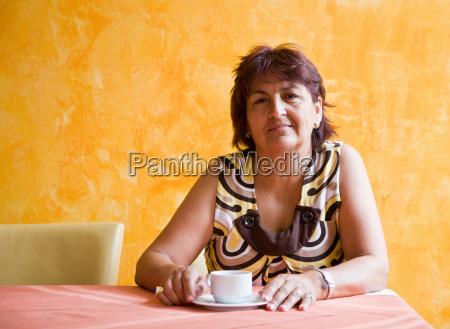 women enjoying a cup of coffee