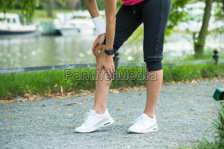 female jogger having pain in her