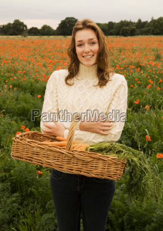 a female holding a basket of
