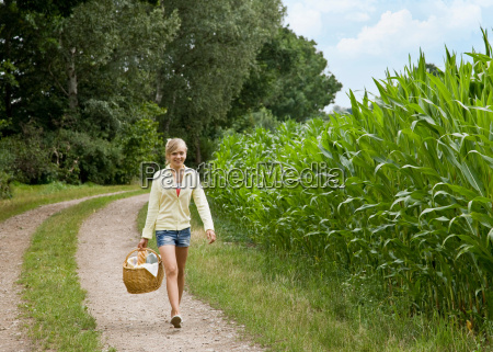 girl walking with a picnic basket