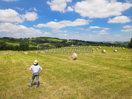 man standing in field
