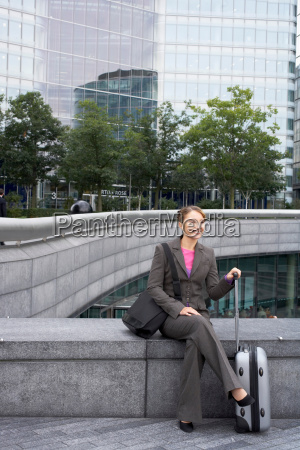 business woman sitting with luggage