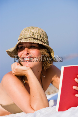 woman reading a book on the