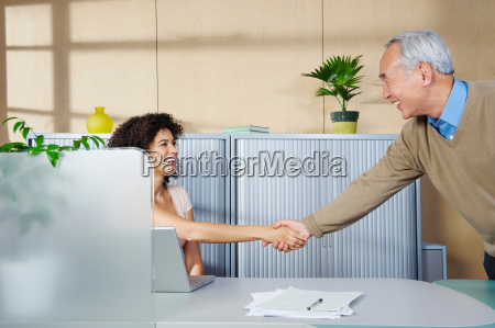 man and woman shaking hands at